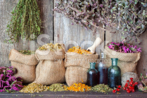 stock-photo-59531388-healing-herbs-in-hessian-bags-and-bottles-of-essential-oil
